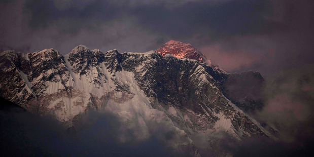 The last light of the day sets on Mount Everest as it rises behind Mount Nuptse as seen from Tengboche. Photo / AP