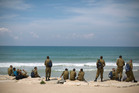 Israeli soldiers look towards the Mediterranean Sea during their basic training as new recruits, in Tel Aviv, Israel. Photo / AP