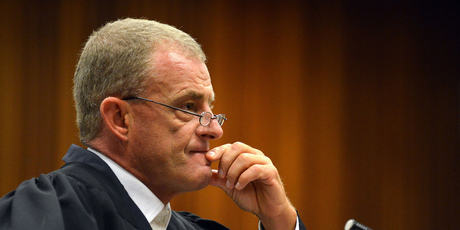 South African chief state prosecutor Gerrie Nel questions Oscar Pistorius in court in Pretoria. Photo / AP
