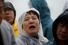 Relatives of passengers aboard a sunken ferry weep at a port in Jindo, south of Seoul, South Korea. Photo / AP