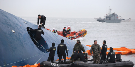 South Korean rescue team members search for passengers aboard a ferry sinking off South Korea's southern coast, in the water off the southern coast near Jindo, south of Seoul. Photo / AP
