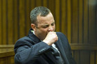 Oscar Pistorius yawns as he listens to forensic evidence being given in court in Pretoria. Photo / AP