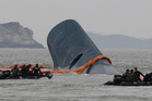 Rescuers have worked through the night trying to reach 290 people still trapped in the sunken ferry. Photo / AP