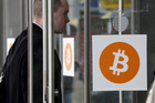 A man enters a Bitcoin conference and trade show held in New York earlier this month. Bitcoin 'miners' are finding it more difficult to make any money from generating new bitcoins. Photo / AP