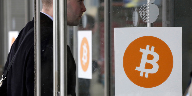 A man enters a Bitcoin conference and trade show held in New York earlier this month.  Photo / AP