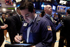 New York Stock Exchange traders are working in top gear as the Nasdaq takes a hammering. Photo / AP