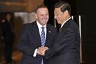 Prime Minister John Key (with Xi Jinping) has gone out of his way to steer Chinese investors away from farmland.