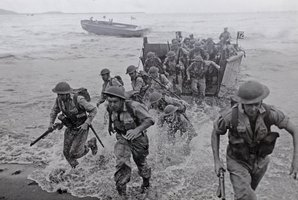 New Zealand forces in the Pacific race ashore from landing craft.
