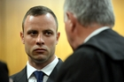 Oscar Pistorius consults his defence attorney Barry Roux at the High Court in Pretoria.Picture / AP