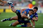 Dominique Peyroux is tackled during the tense match against the Bulldogs. Photo / Sarah Ivey