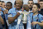 Manchester City players, celebrating with the 2014 League Cup, are on average the highest paid in sport. Photo / AP