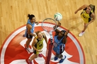 Steel shooter Jhaniele Fowler (right) goes for goal last night against the Steel in Invercargill. Photo / Dianne Manson