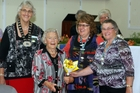 Coie O'Brien, centre left, receives her 80-year service badge. From left, Jeanette Andrews, National President, Coie O'Brien, Suzanne Bannister, Wairarapa President, and Shirley O'Brien.
