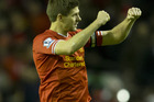 Steven Gerrard celebrates his team's 3-2 win over Manchester City at Anfield. Photo / AP