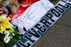 Tributes left by fans at Anfield for the 25th anniversary of the Hillsborough tragedy. Photo / AP