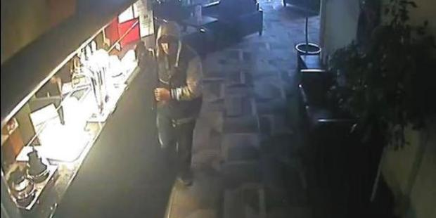 The robber was caught on CCTV images.
