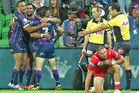 Young Tonumaipea of the Storm is congratulated by teammates after scoring against the Dragons. Photo / Getty Images