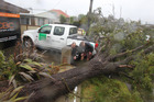 Wet Weather. Paul Taylor and Murray King from Classic Builders inspect damage done after a tree fell.