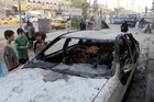 The aftermath of a bomb attack this week in a crowded commercial street in Baghdad. Photo / AP
