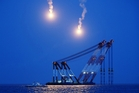 Flares light up the sea for South Korean rescue teams searching for missing passengers. Photo / AP