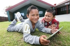 HIGH TECH: Malachi Loveridge, 9, with brother Blair, 5, try out a tablet computer at Te Kotahitanga Marae which will house the ICT hub. PHOTO / MICHAEL CUNNINGHAM