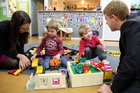 Labour MPs Jacinda Ardern (left) and Chris Hipkins play with 3-year-old Pearse Campbell (left) and 4-year-old Mason Schipper at Wanganui's Central Baptist Early Childhood Centre. Photo/Stuart Munro
