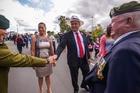 Shane Jones greets servicemen at the Manurewa Anzac Day parade, accompanied by his partner Dot Pumipi. Photo / Jason Dorday