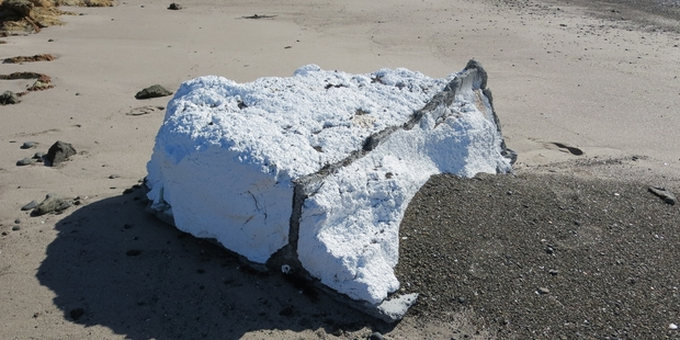 DoC says the disintegrating, 1m-thick chunks of polystyrene pose a threat to wildlife such as bottlenose dolphins. Photo/Peter Beadle