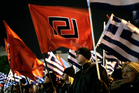Supporters of ultra nationalist party Golden Dawn hold party flag and Greek flag . Photo / AP