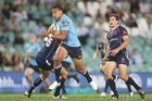 Israel Folau's stride seems a bit longer than that of others, especially when he's beating the tackle. Photo / AP