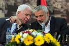 Senior Fatah official Azzam al-Ahmad (left) and Gaza's Hamas Prime Minister Ismail Haniyeh at yesterday's announcement. Photo / AP