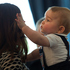 Catherine, Duchess of Cambridge holds Prince George of Cambridge during a Plunket nurse and parents group visit at Government House in Wellington. Photo / Getty Images