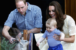 Catherine, Duchess of Cambridge holds Prince George of Cambridge as Prince William, Duke of Cambridge looks on whilst meeting a Bilby called George at Taronga Zoo. Photo / Getty Images