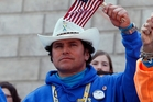Spectators cheer on marathon runners including Carlos Arredondo who last year pulled a man, whose legs had been blown off, to safety. Photo / AP