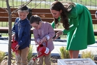 Twins Oliver and Sebastian Lye helped Kate water in the newly-planted English oak tree. Photo / Getty Images