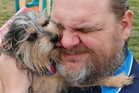 Jerry Starr refused to abandon his dog Tobi during the tornado and stayed outside a shelter with his pet. Photo / AP