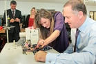 Kilt Clothing production manager Cushla Sampson shows Prime Minister John Key how to operate the sewing machine. Photo/Warren Buckland