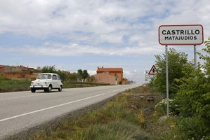 A car passes by the road sign at the entrance of the small Spanish town of Castrillo Matajudios, which means Castrillo Kill Jews in English, near Burgos. Photo / AFP