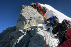 Climbers navigate the Hillary Step just below the summit of Mount Everest. Photo / AP/Alpenglow Expeditions