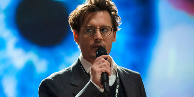 Johnny Depp in a scene from Transcendence. Photo/AP