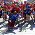 Dick Hoyt and Rick Hoyt, from Holland, Mass., cross the finish line surrounded by supporters in the 118th Boston Marathon. Photo / AP