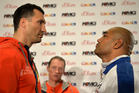 Boxing champion Wladimir Klitschko of Ukraine, left, stares at challenger Alex Leapai from Australia-Samoa during a press conference ahead of their heavyweight bout. Photo / AP