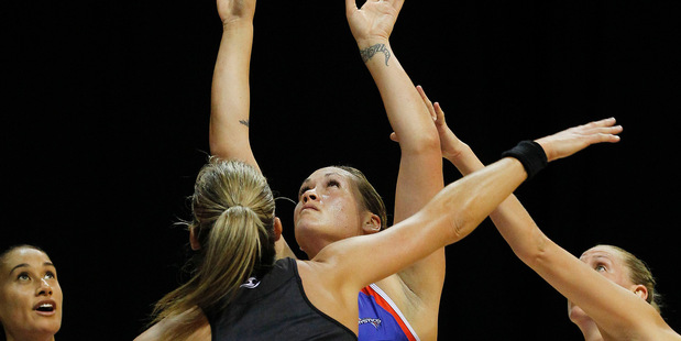 Mystics shooter Cathrine Latu goes for goal while Magic defenders Leana de Bruin, left, and Casey Kopua attempt to put her off during their ANZ Championship netball match in Hamilton last night. Photo / Christine Cornege
