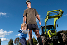 Reporoa dairy farmer Ross Shaw, with son Bailey, prepared for another dry spell by stockpiling supplement feed and silage. Photo/Ben Fraser
