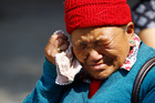 Mother of Nepalese mountaineer Ang Kaji Sherpa, killed in an avalanche on Mount Everest, cries while she waits for his body. Photo / AP