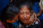 A relative of one of the Nepalese climbers killed in an avalanche on Mount Everest. Photo / AP