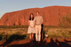 Britain's Prince William and his wife, Kate, Duchess of Cambridge, pose for a photo at sunset in Uluru, Australia. Photo / AP