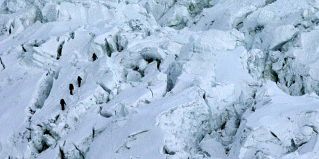 Mountaineers pass through the treacherous Khumbu Icefall on their way to Mount Everest. Photo / AP