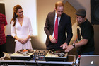 Prince William and Kate try their hand at DJ-ing at an Adelaide youth centre yesterday. Photo / Getty Images