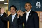 President Barack Obama and Japanese Prime Minister Shinzo Abe depart Sukiyabashi Jiro sushi restaurant in Tokyo. Photo / AP